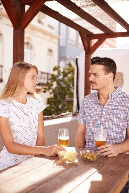 Handsome young couple having some drinks stock photo