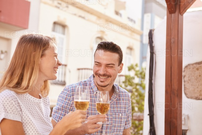 Happily laughing couple drinking some beers stock photo