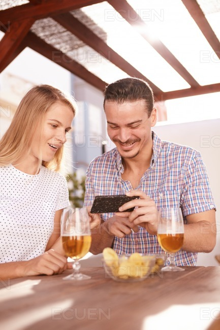 Happy couple looking at a cellphone stock photo