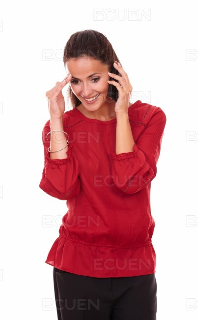 Happy latin lady talking on her phone stock photo