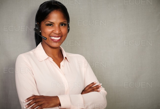 Happy receptionist smiling at the camera stock photo