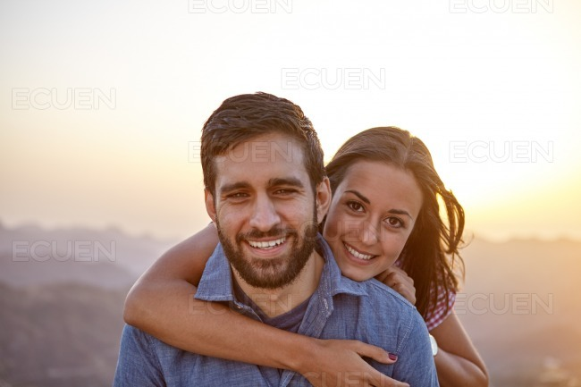Happy young couple posing for a picture stock photo