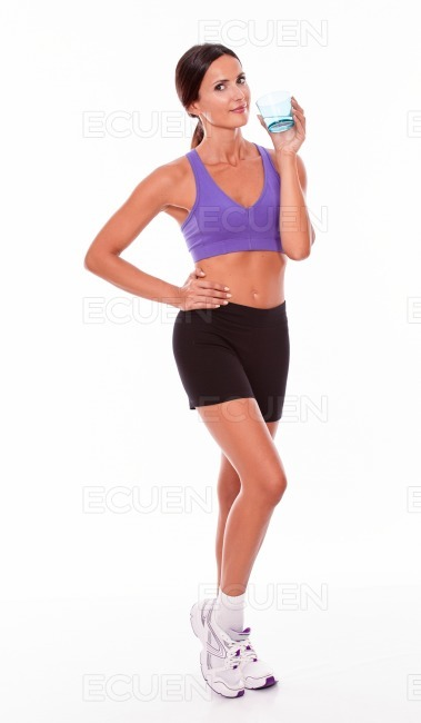 Healthy brunette with a glass of water stock photo