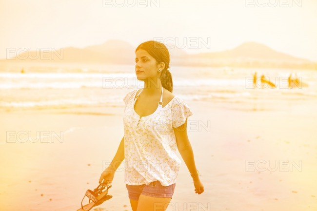 Healthy young brunette girl on the beach
