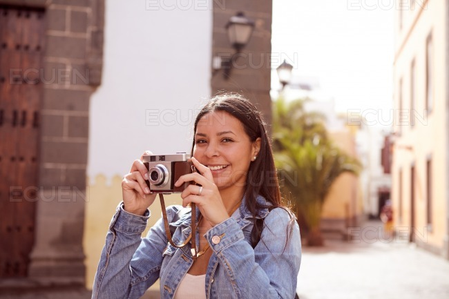 Long haired brunette looking at camera stock photo