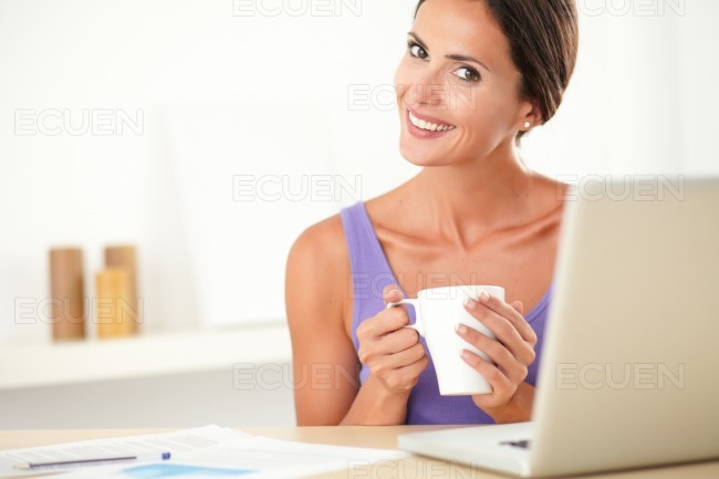 Lovely female person sitting and surfing web