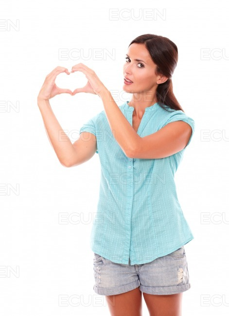 Pretty lady making a love sign with hands stock photo