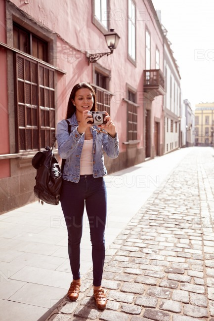 Pretty young girl focusing to taking a picture stock photo