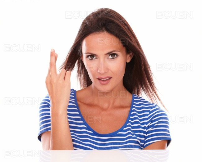 Sexy Girl Smiling And Crossing Fingers Stock Photo