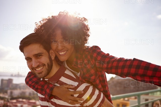 Smiling for camera young milennial couple stock photo