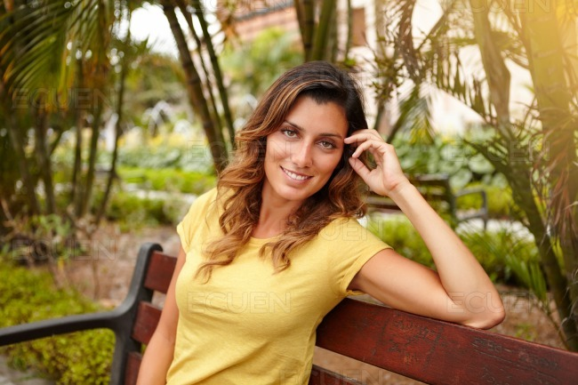 Smiling lady looking at camera with hand in hair stock photo