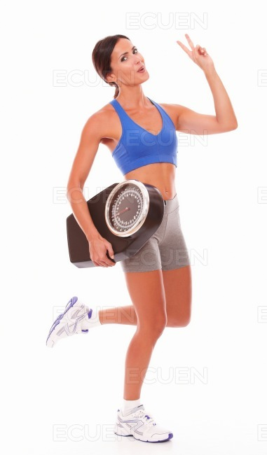 Sport pretty woman measuring weight loss