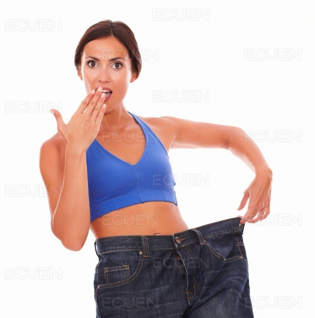 Sporty woman looking surprised on weight loss stock photo