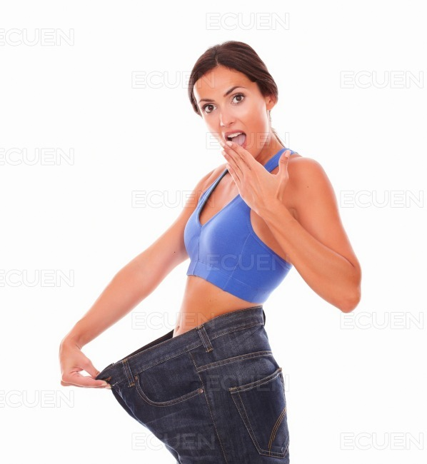 Sporty young woman looking surprised on body shape stock photo