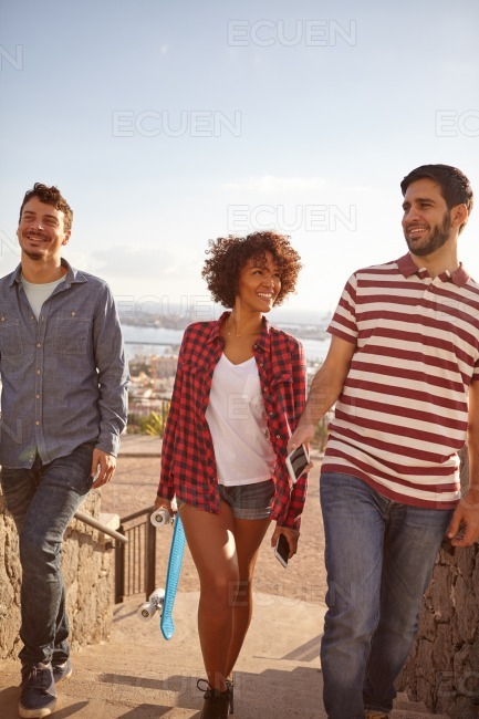 Three cool joking and laughing friends stock photo