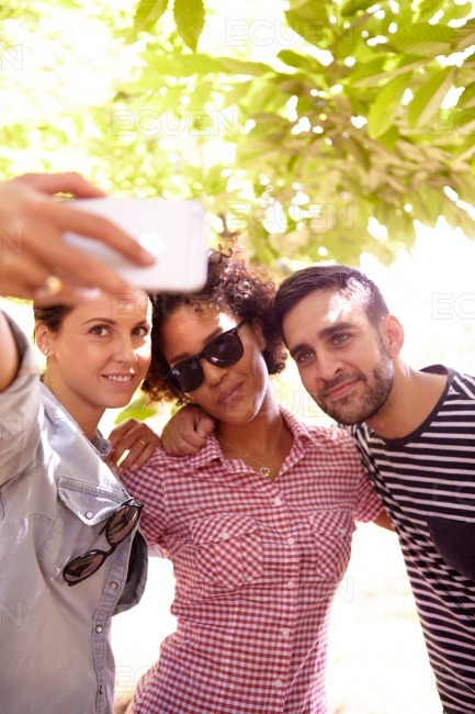 Three friends posing for a selfie stock photo