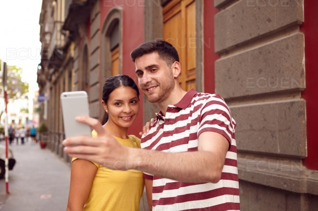 Very happy young couple taking a selfie stock photo