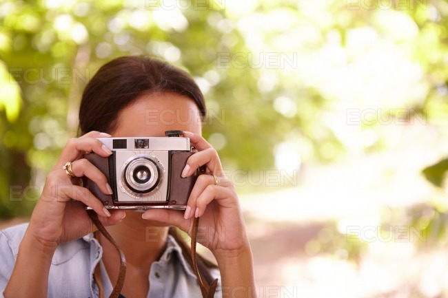 Woman taking a picture with a camera stock photo