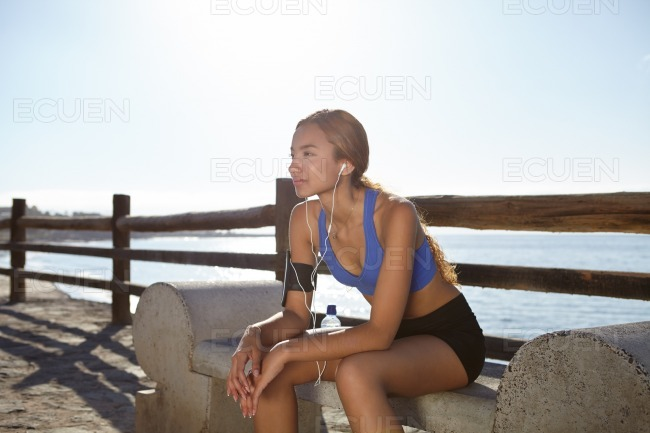 Young athlete sitting outside in summertime stock photo