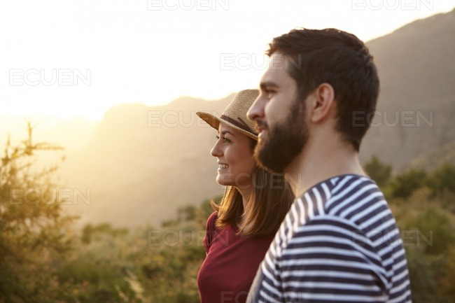 Young couple looking out over mountains stock photo