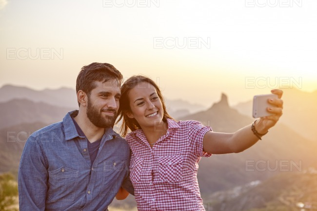 Young couple on a mountain top stock photo