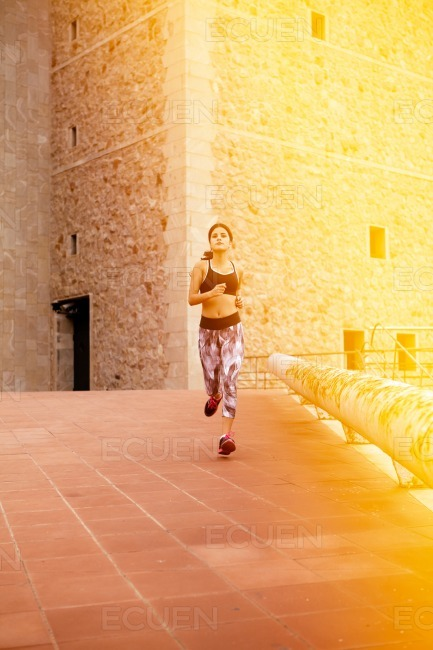Young female brunette taking a run stock photo