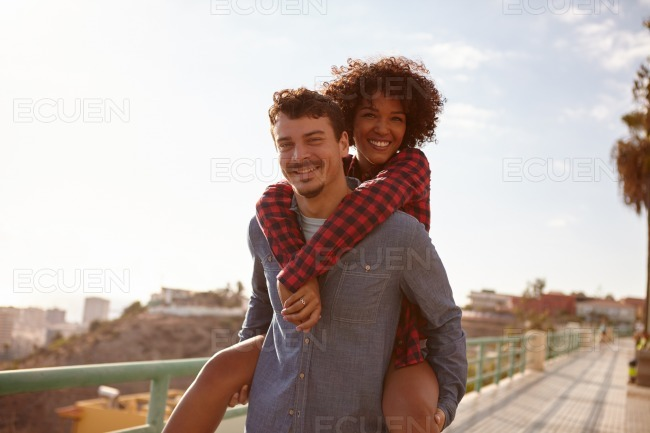 Young girl getting a piggy back stock photo