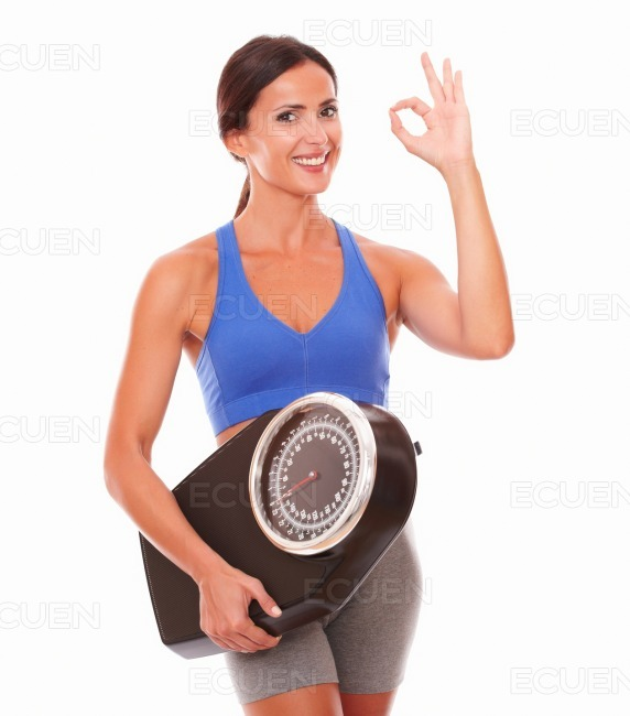 Young latin woman feeling happy with weight