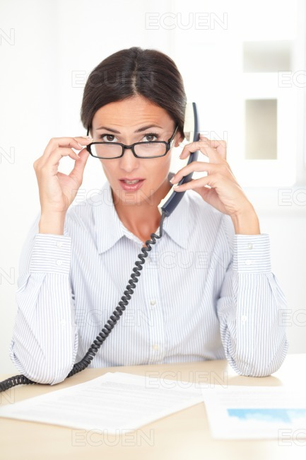 Young receptionist conversing on the phone