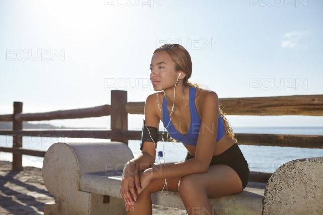 Young runner resting after jogging outdoors stock photo