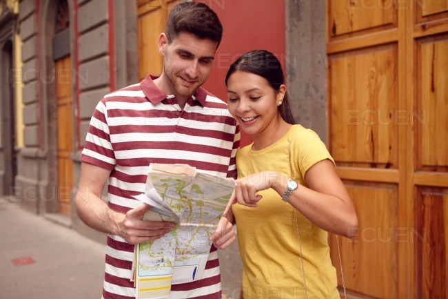 Young tourist couple finding their location on map stock photo