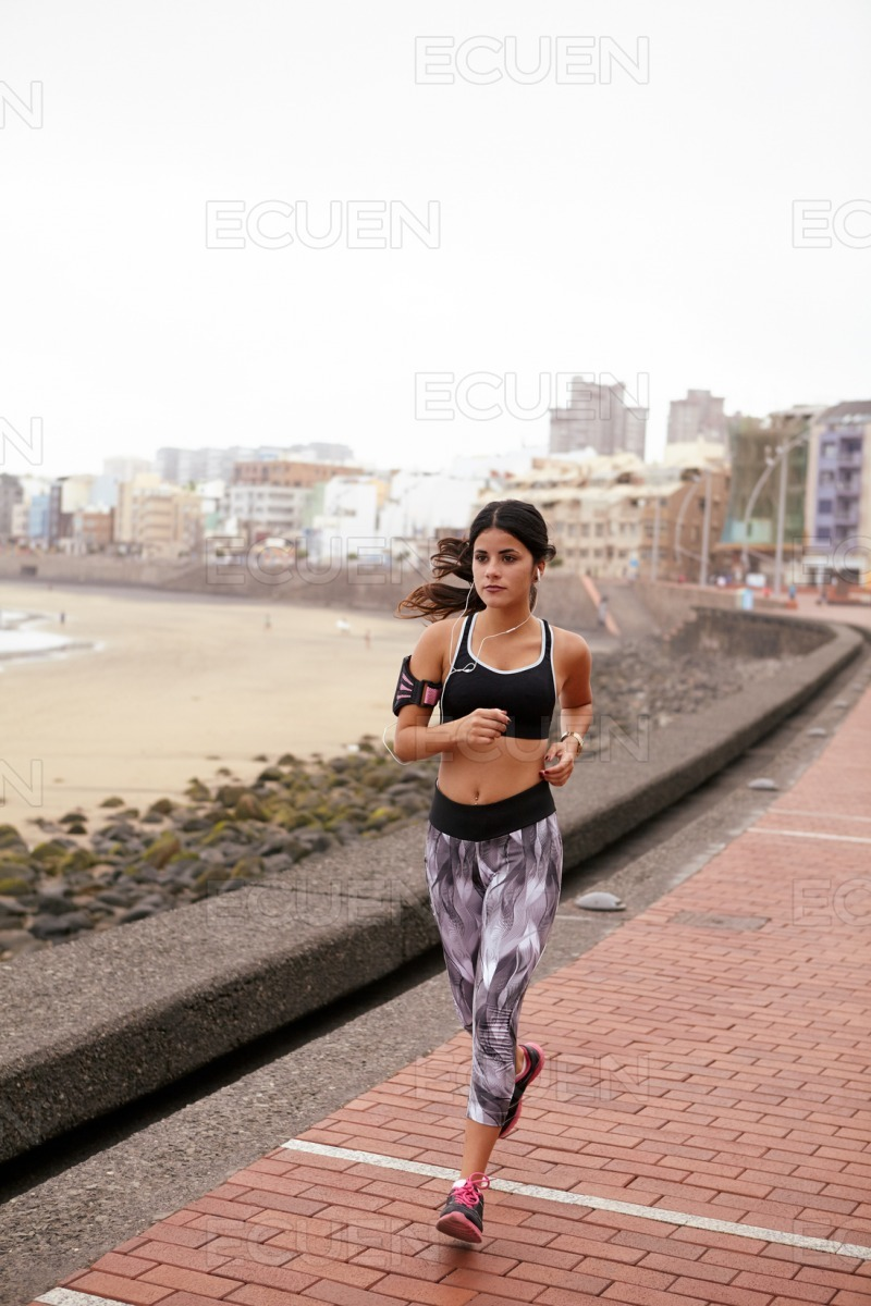 Young girl running in the city stock photo