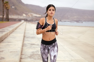 Determined young brunette going for a run