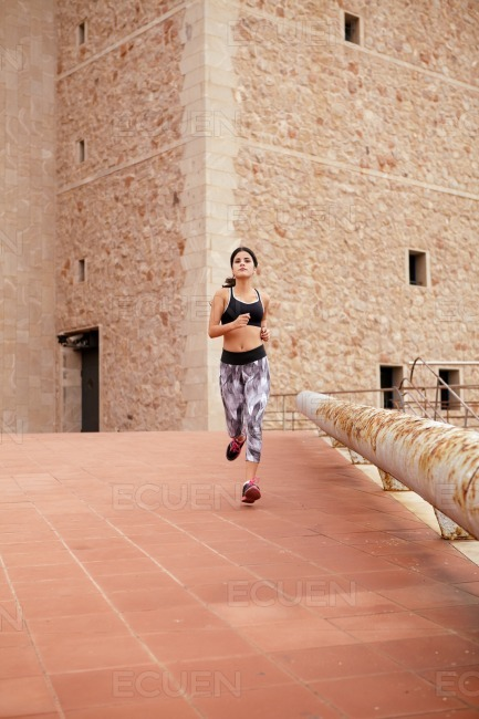 Young female brunette taking a run