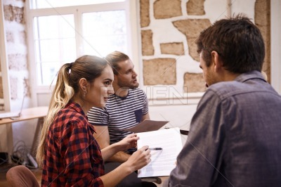 Three young professionals in brainstorming group