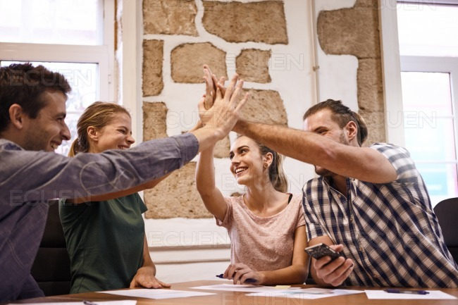 Business team concluding success in meeting stock photo