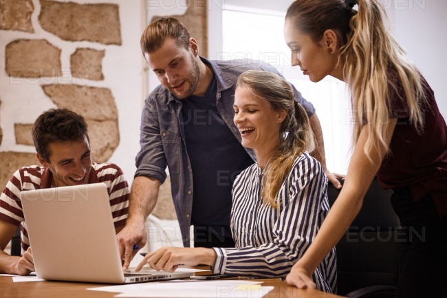 Happy young business team in meeting stock photo