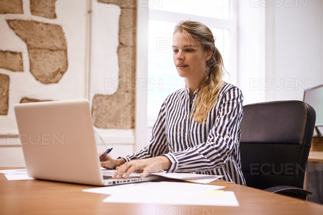 Professional business woman preparing for meeting stock photo