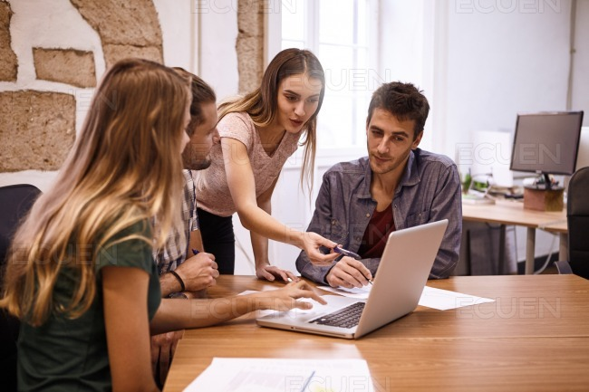 Team of four professionals in meeting stock photo