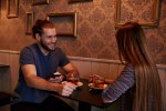 Dating young couple in a pub
