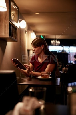 Beautiful young woman with her tablet