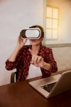 Gesturing young lady with 3d viewer
