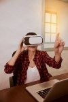 Gesturing young woman with 3d viewer