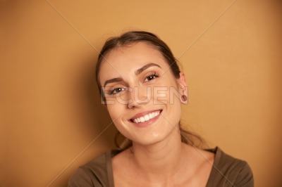 Beautiful young woman smiling for camera