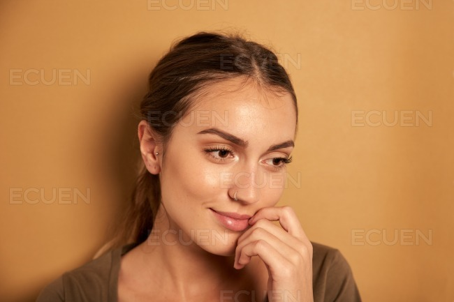 Dreamy young woman posing for camera stock photo