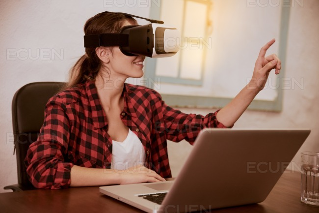 Smiling young woman with 3d viewer stock photo