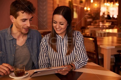 Close couple sharing while in restaurant