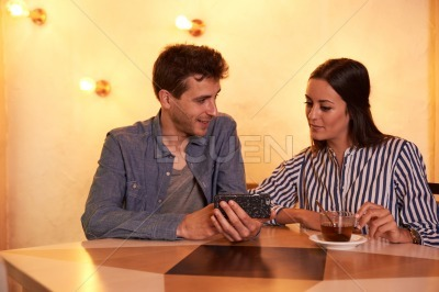 Couple looking at pictures on cell phone