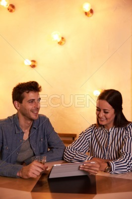 Joyously smiling young couple in restaurant