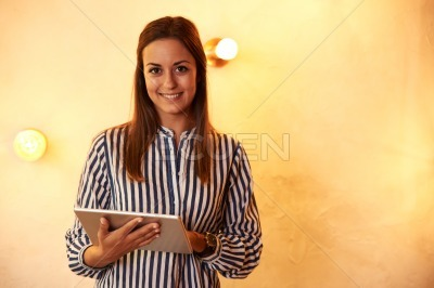 Millennial posing for camera with smile